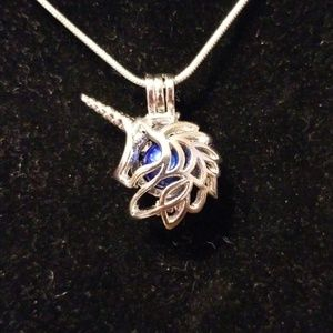Unicorn head with oyster pearl necklace
